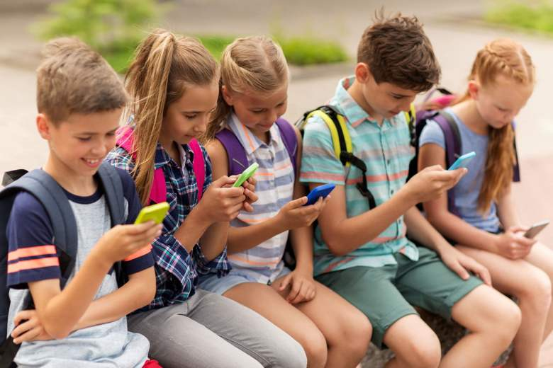 stock-kids-on-cell-phone